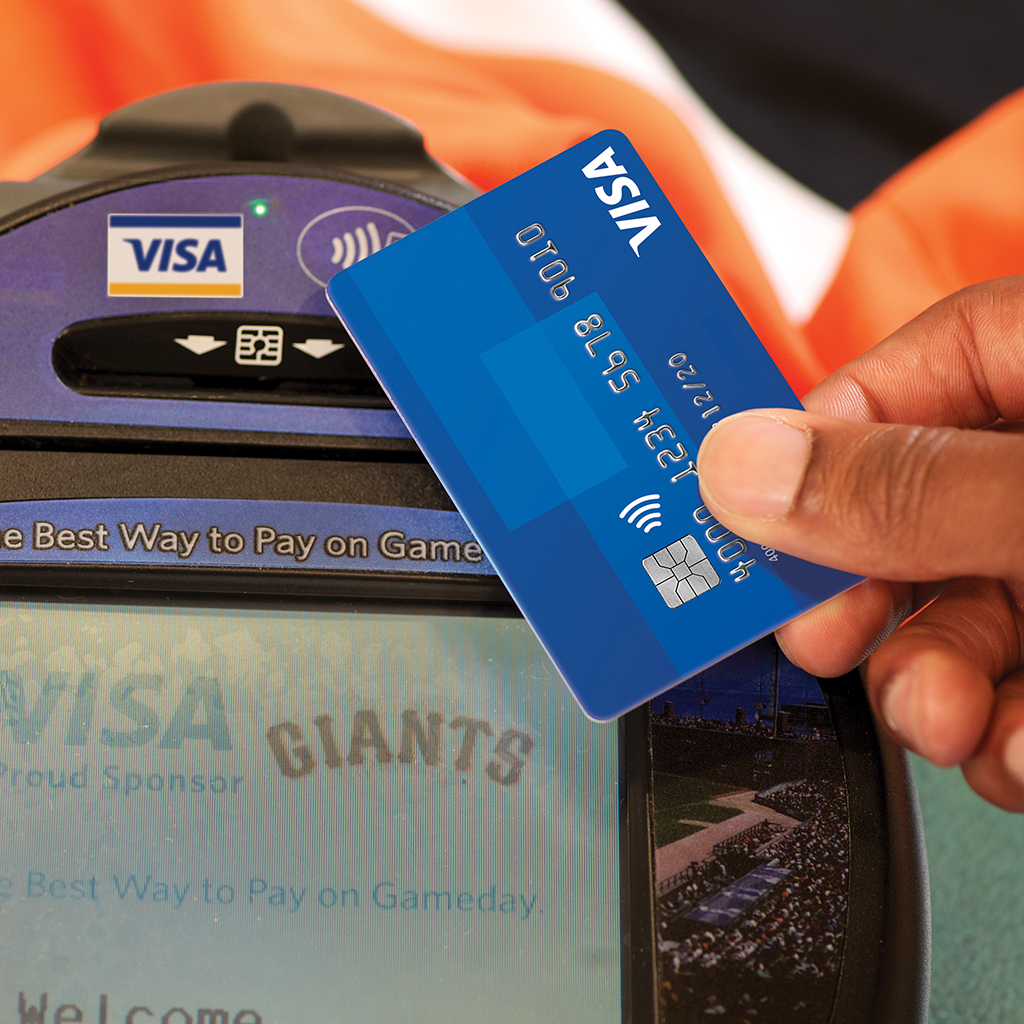 Close up of contactless Visa credit card payment.